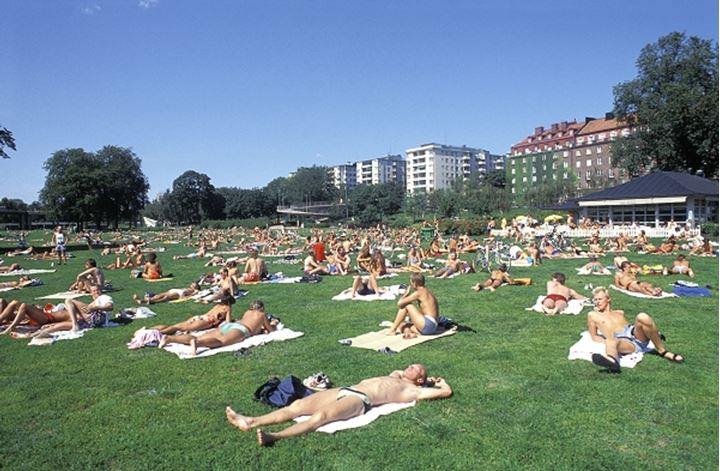 Sweden, Stockholm - people in park in summer