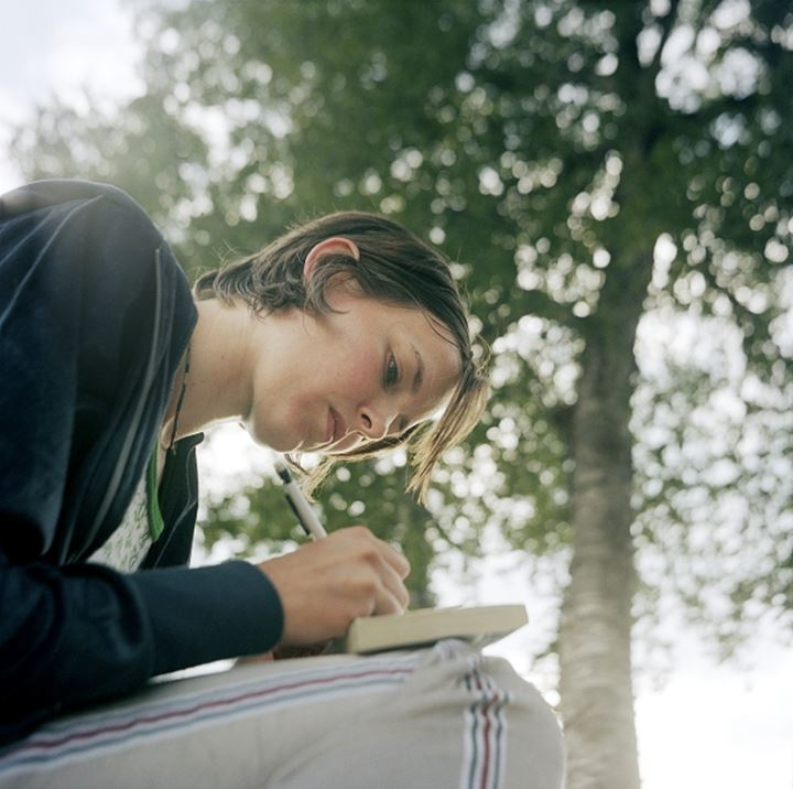 A woman writing in a book