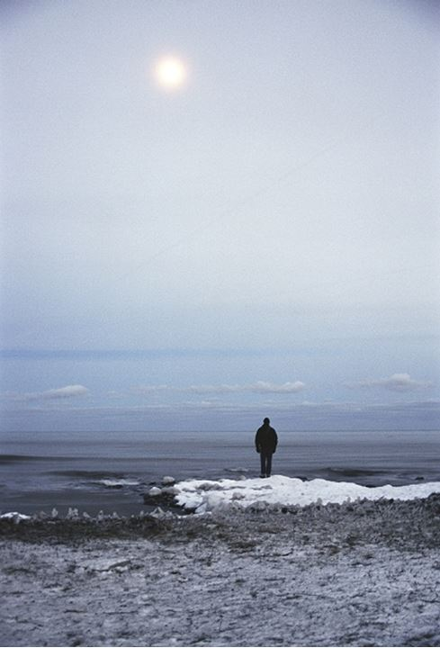 A person standing by the sea