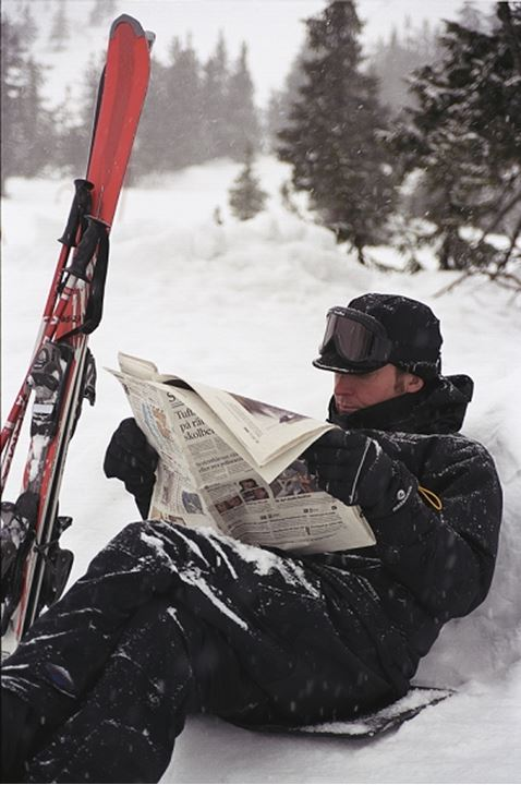 A skier reading a newspaper, Norway