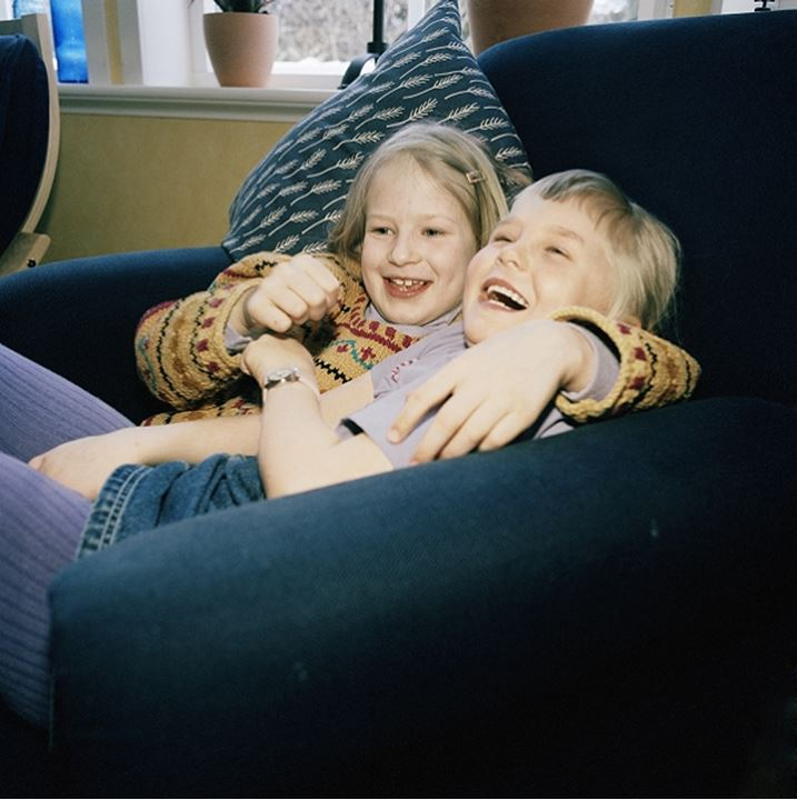 two girls palying in big soft chair