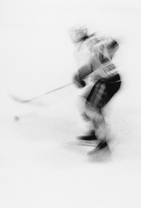 Blurry view of a hockey player in motion