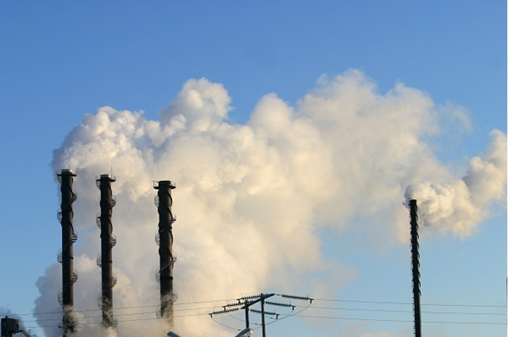 Smoke emitting from the chimneys in an industry