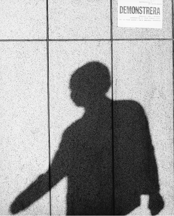 Shadow of a person casting on tiled wall