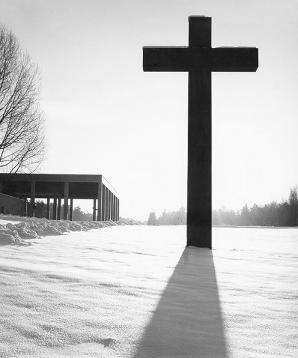 A cross buried in snow