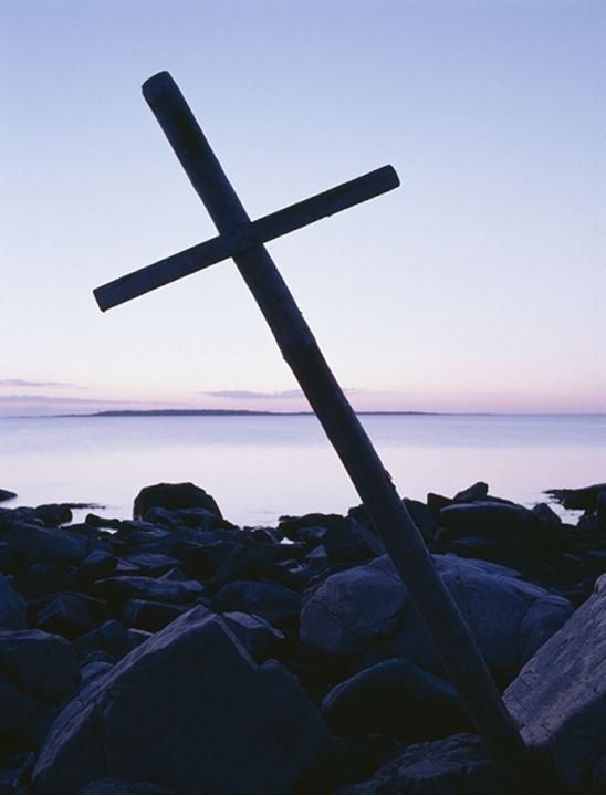 A wooden cross by the seashore