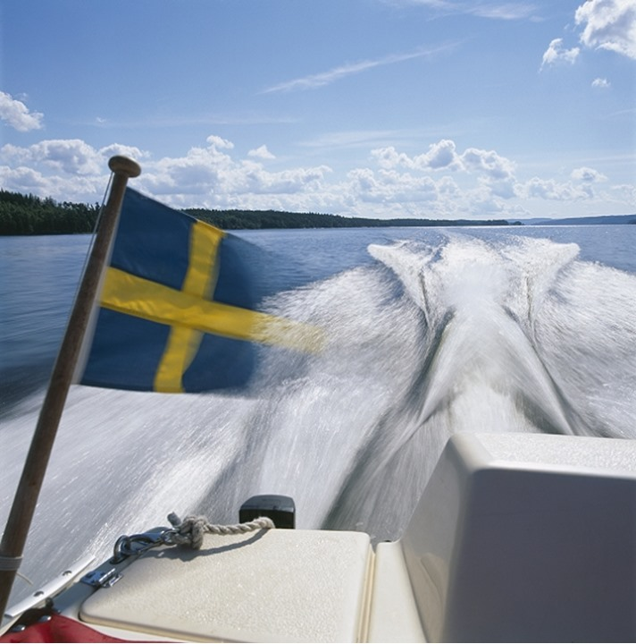 A speedboat with the Swedish flag
