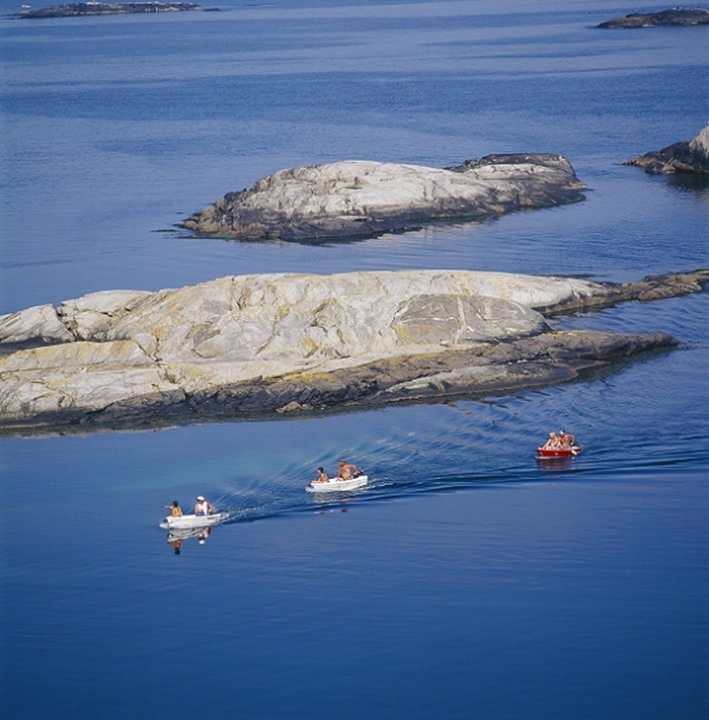 People sailing on small boats by the Koster islands