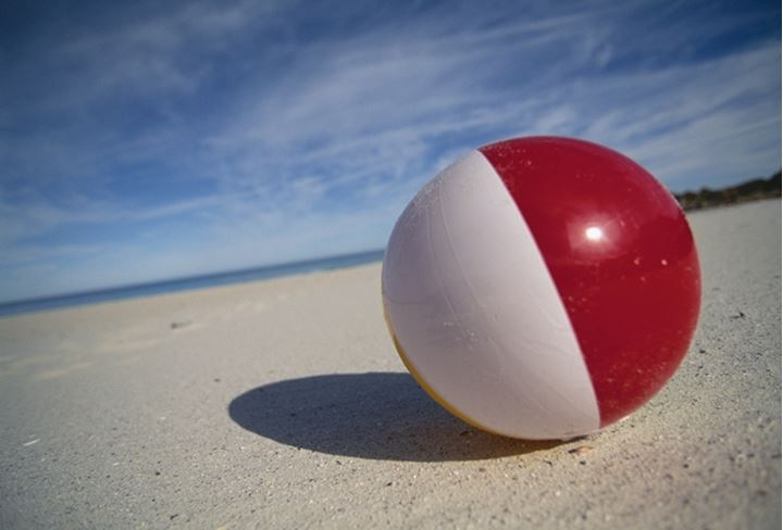 Close-up of a colorful beach ball on the beach
