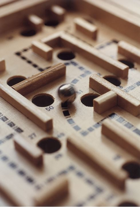 Close-up of a maze puzzle game