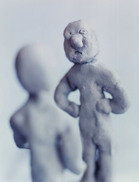 Close-up of two figurines