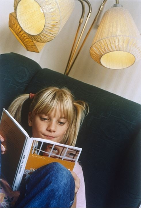 Close-up of a girl reading a book