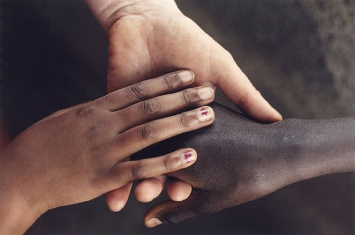 Close-up of a person's hands holding another person's hand