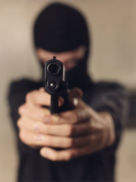 Close-up of a person holding a handgun