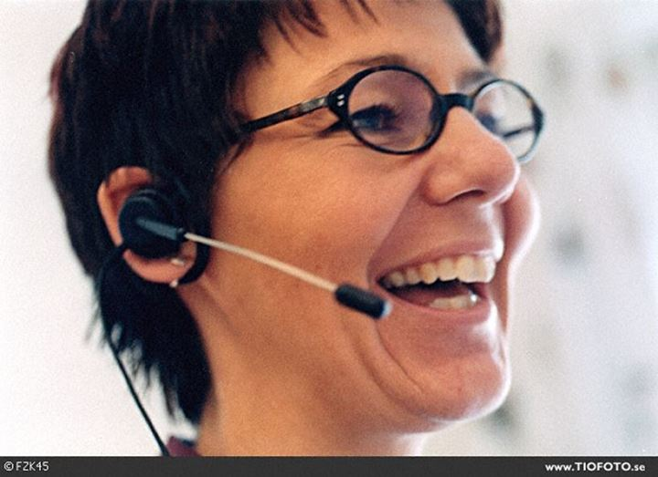Close-up of a customer service representative wearing a headset and laughing