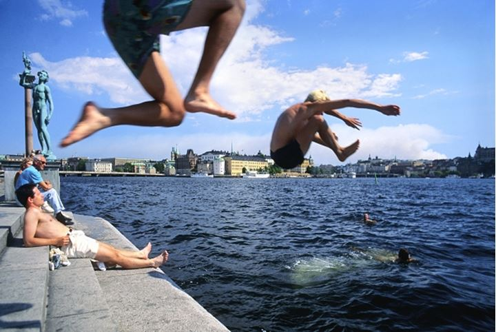 Stockholm - young people diving in Lake Mälaren in summer