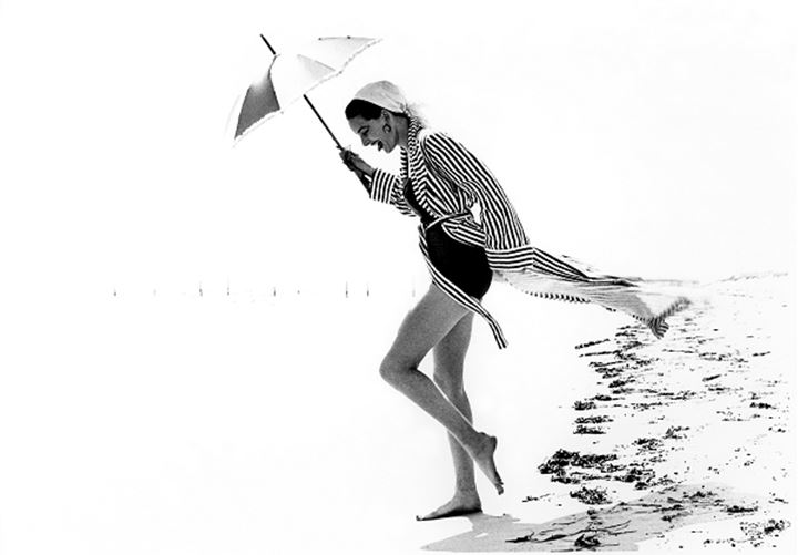 Woman on the beach with umbrella