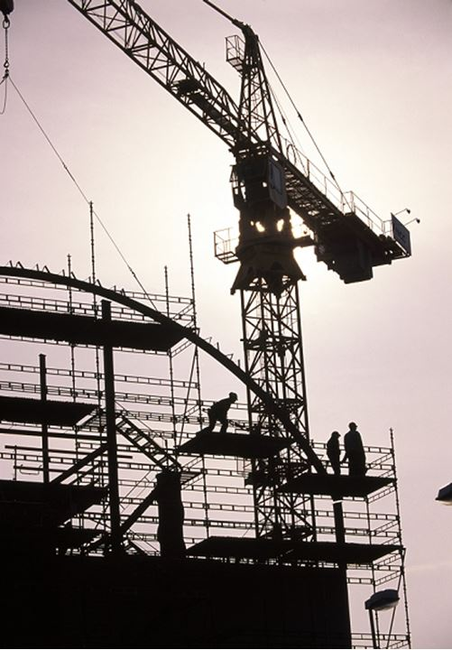 Construction workers on a crane