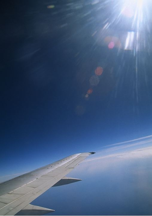 Wing of aircraft in sunlight
