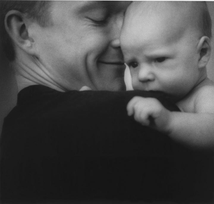 A father holding his little baby,Sweden