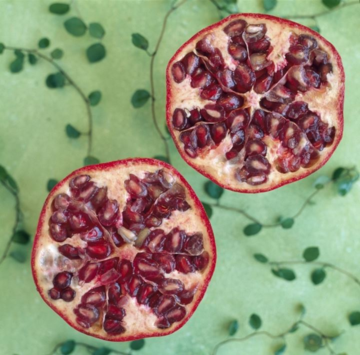 Close-up of two halves of pomegranate