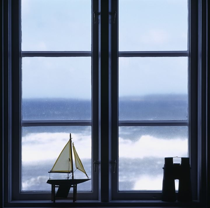 Model yacht on a window-sill against sea
