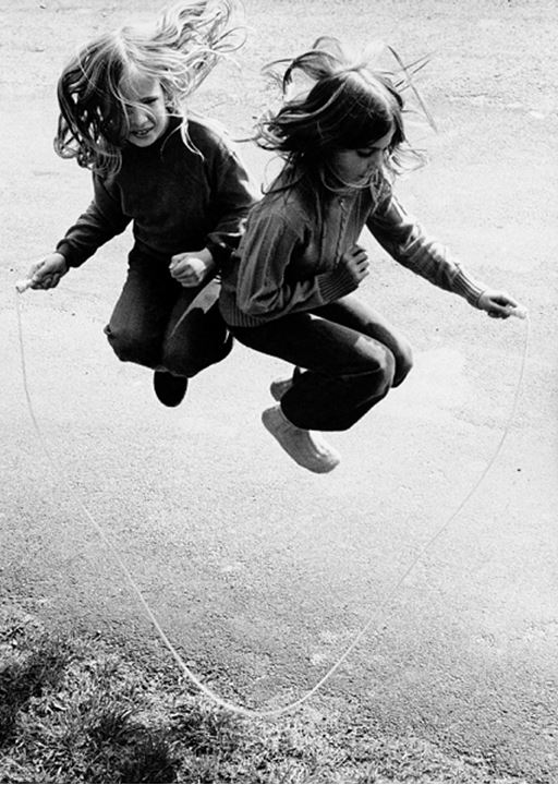 Two girls jumping with a jump rope