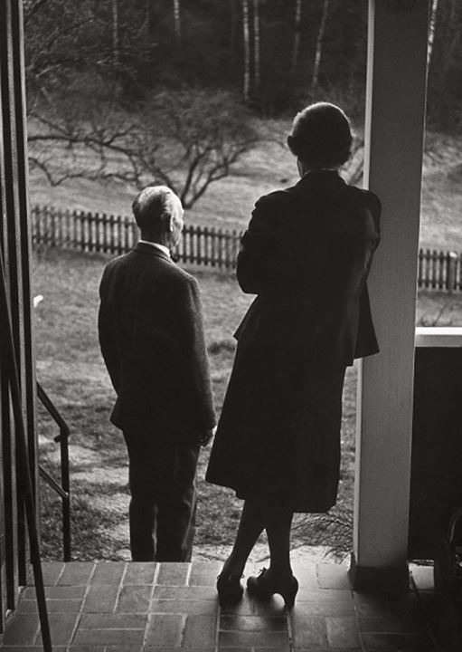 Rear view of a senior couple waiting at a door