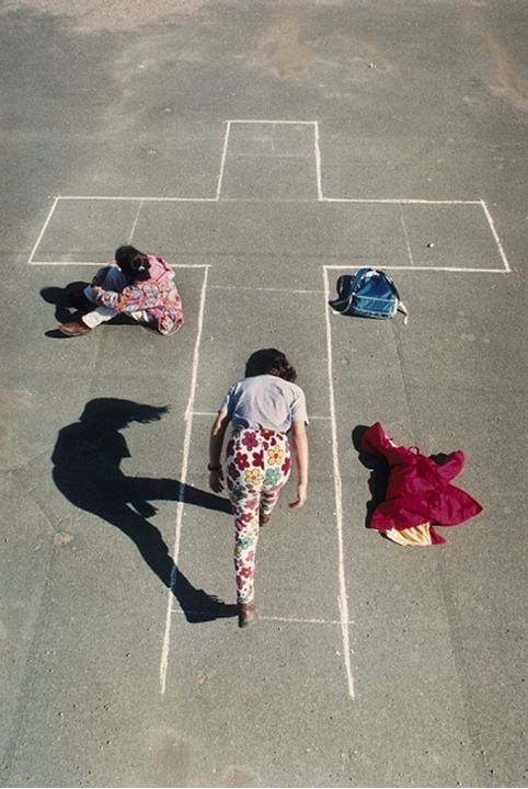 High angle view of a girl playing hopscotch