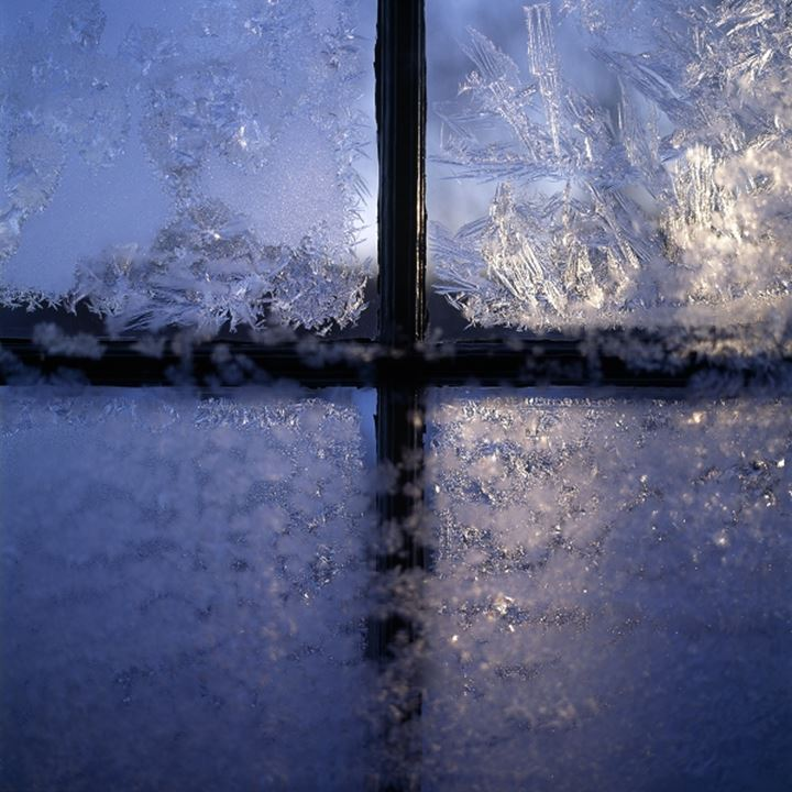 Frozen ice on the glass of a window