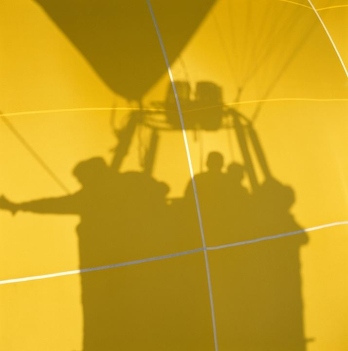 Shadow of four people in a hot air balloon