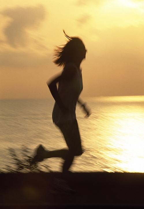 Silhouette of a woman jogging