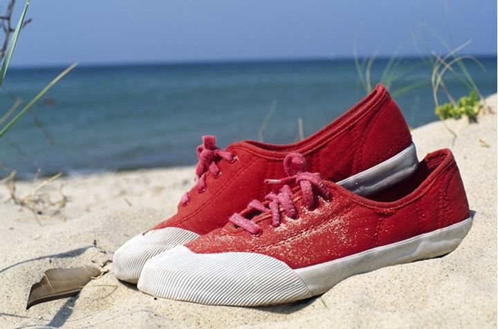 Close-up of a pair of shoes on the beach