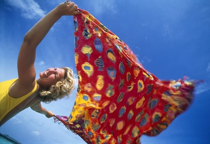 Woman with colourful cloth on a windy day