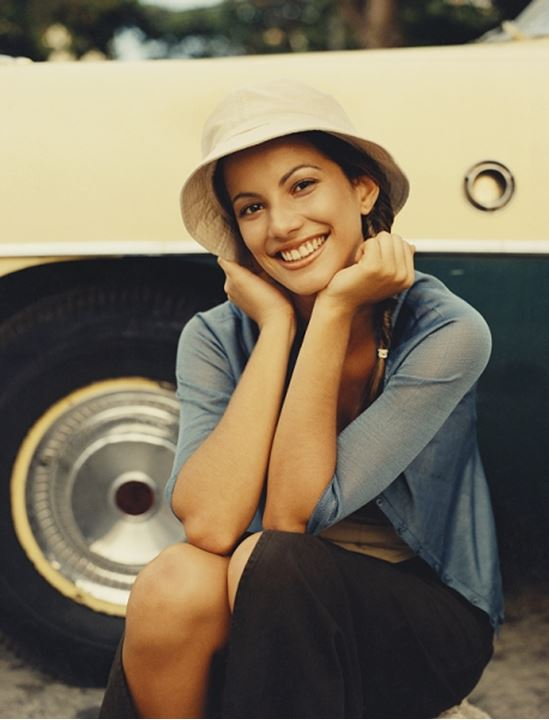 A smiling woman with a hat