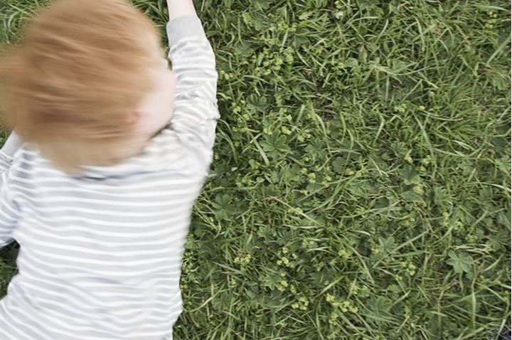 A boy lying on the grass. Stockholm