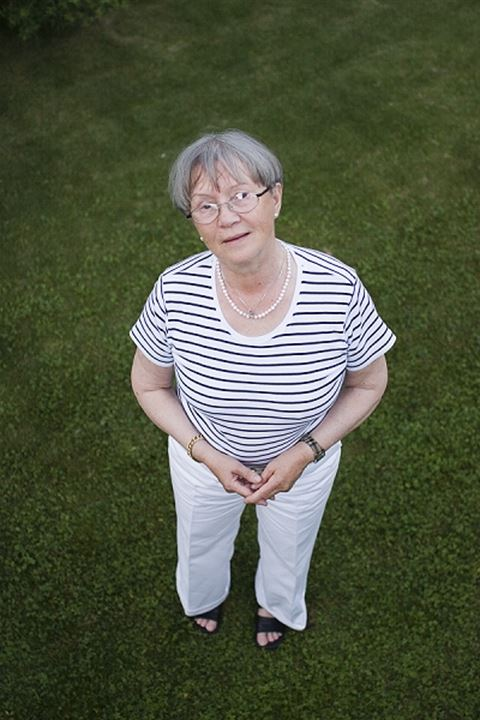 A woman standing on a lawn, Sweden