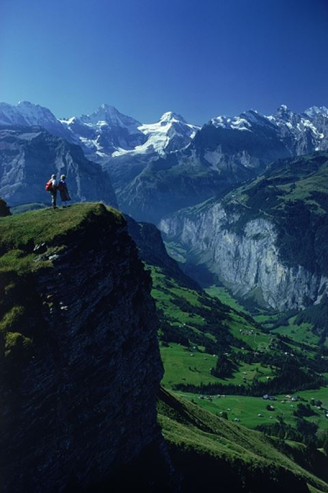 Swiss hikers above Lauterbrunnen near Grindenwald with Breithorn Peak at 3782m