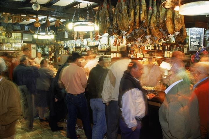 People eating and drinking in cantina in San Sebastian Spain