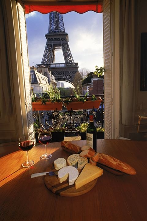 Wine cheese and bread in apartment near Eiffel Tower
