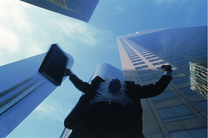 Businessman raising arms in downtown Los Angeles