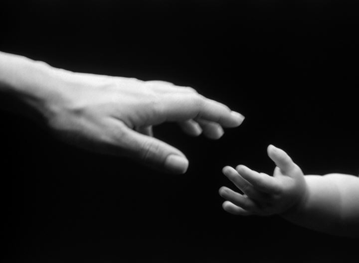 Mother and child reaching for eachother