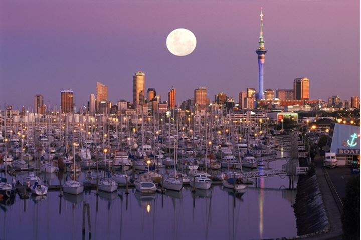 Moon setting over Waitemata Harbour (Westhaven Harbour) with Sky Tower in Auckland skyline