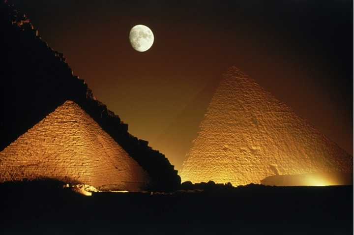Moon over Pyramids of Giza at night in Egypt