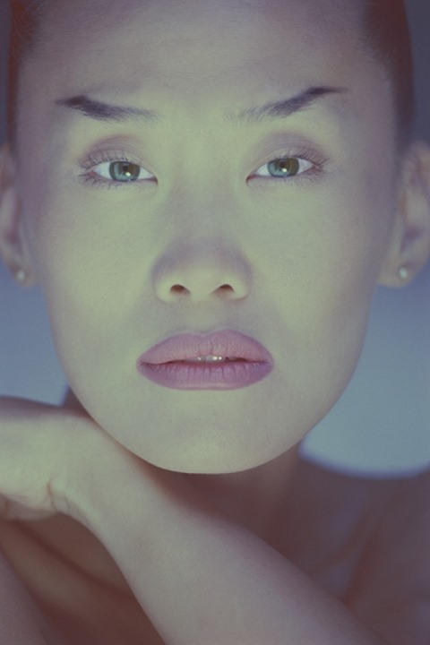 Portrait of Asian woman looking toward camera