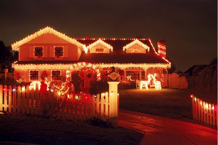 House with Christmas decorations in California at night