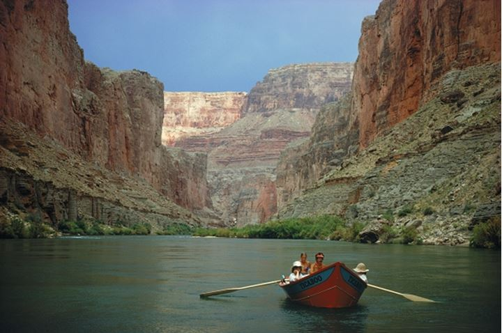 Passing through Grand Canyon walls in tiny dory on Colorado River