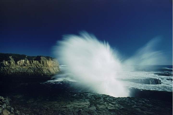 Storm wave hitting rocky shore at Big Sur California