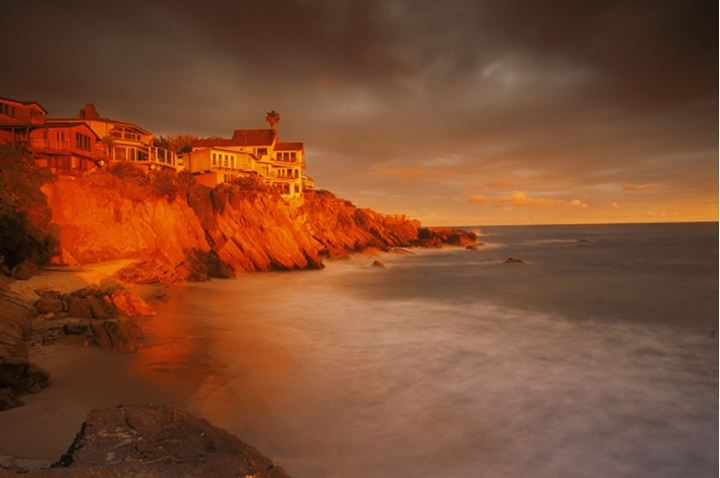 Coastal homes at Woods Cove in Laguna Beach in sunset light  Southern California