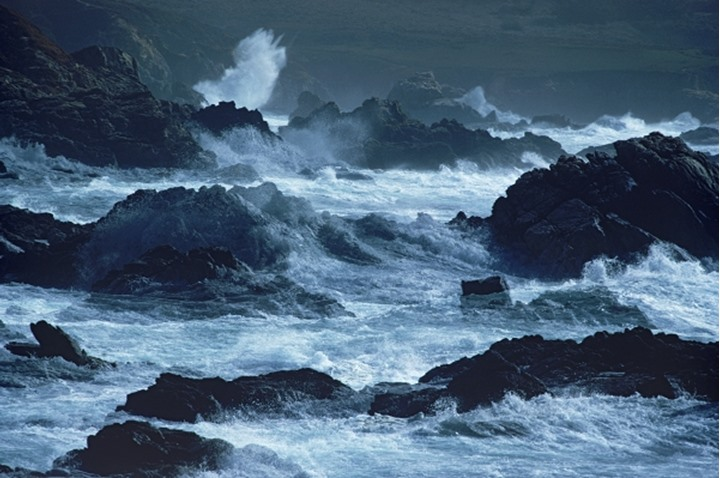 Storm waves hitting rocky coast at Big Sur California